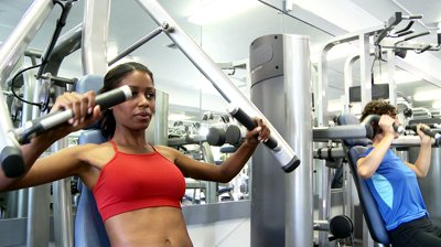 stock-footage-two-young-women-friends-working-out-at-gym